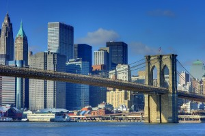Picture of Brooklyn Bridge as the clouds part on a sunny day.